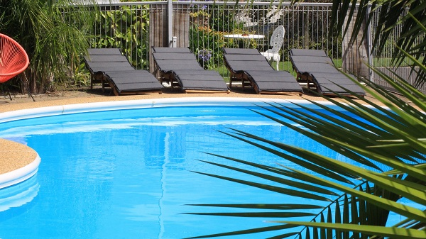 Relax by the Pool at Ocean View Motel